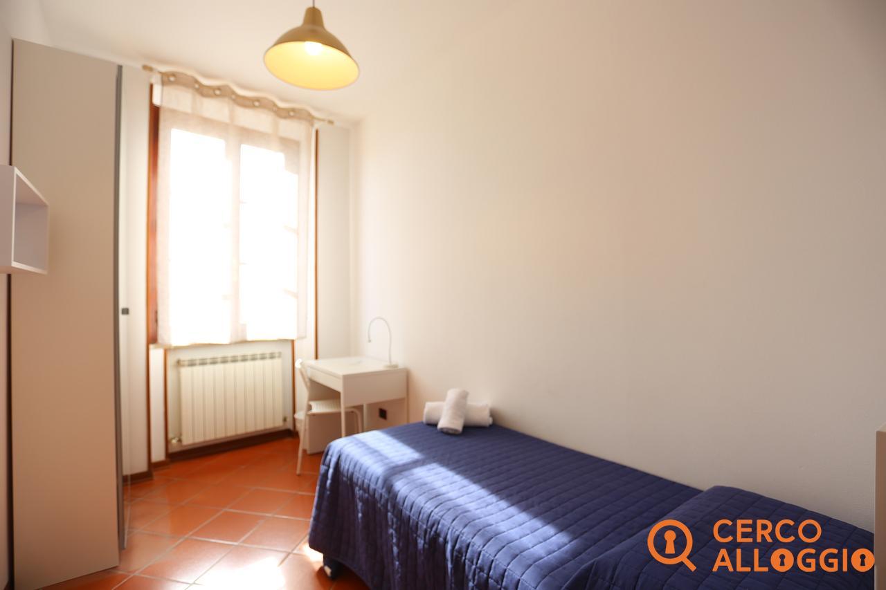 Copertina camera in affitto a Siena